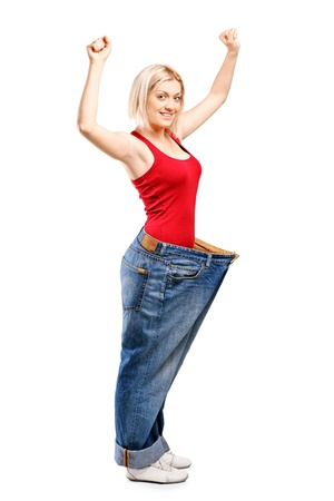 Full length portrait of a happy weight loss female isolated on white background photo