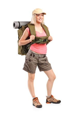 Full length portrait of a woman in sportswear with backpack posing isolated on white background Stock Photo - 9986543
