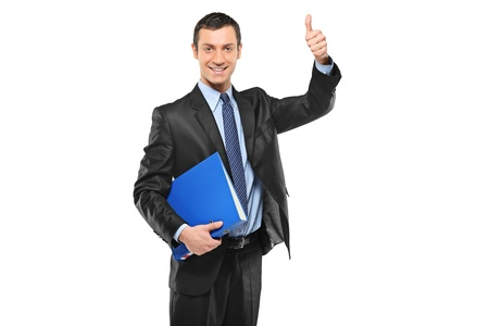 fascicule: A happy businessman holding a fascicule with documents and giving thumb up isolated on white background