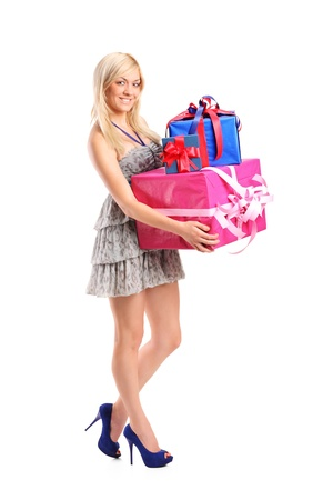 Full length portrait of an  attractive woman holding a gifts isolated on white background photo