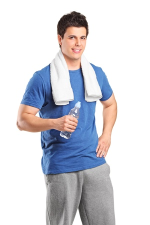 Young athletic man smiling with water bottle after his exercising at gym isolated on white background photo