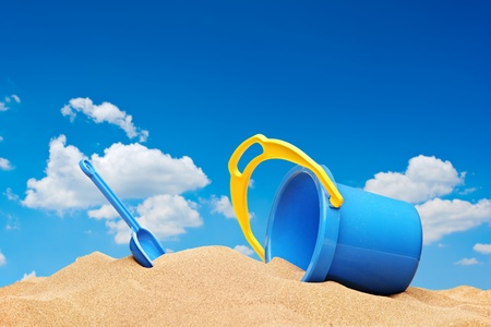A view of a bucket and scoop at the beach with sky in the background Stock Photo - 10105411