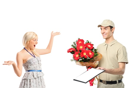 delivery boy: A delivery boy delivering a bunch of flowers and surprised woman isolated on white background Stock Photo
