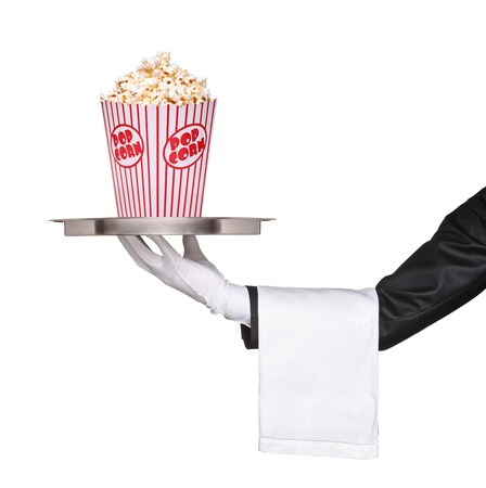 A waiter holding a silver tray with popcorn box on it isolated on white background photo