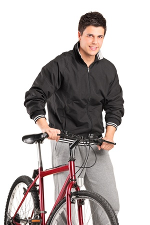 A young boy posing on a bike isolated against white background photo