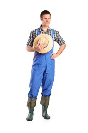 dungarees: Full length portrait of a male farmer posing isolated against white background