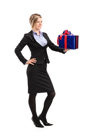 Full length portrait of an attractive woman holding a gift isolated on white background Stock Photo - 10105339