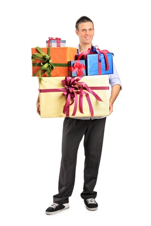 Full length portrait of a young male holding gifts isolated on white background photo