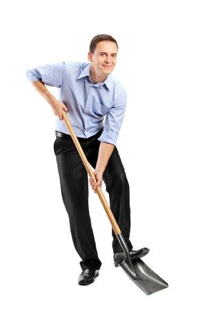 shovel: Full length portrait of a businessman  holding a shovel isolated on white background Stock Photo