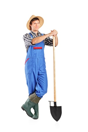 Full length portrait of a male worker holding a shovel isolated on white background photo