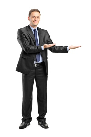 Full length portrait of a man in suit gesturing welcome isolated on white background photo