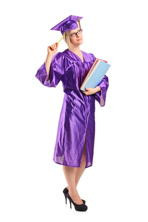 Full length portrait of a graduate student in thoughts holding a book isolated on white background photo