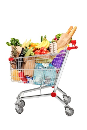 shopping trolleys: A shopping cart full with groceries isolated on white background Stock Photo