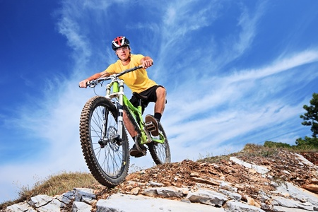 mountain bicycle: A young male riding a mountain bike outdoor Stock Photo