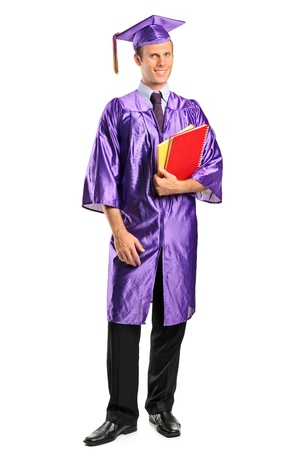 Full length portrait of a graduate student holding books isolated on white background photo