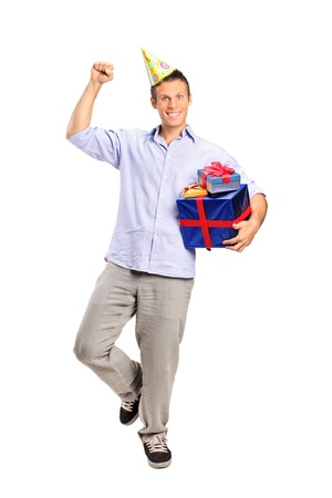 Full length portrait of a person wearing a party hat and holding a gift isolated on white background photo