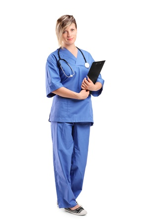 Full length portrait of a smiling healthcare professional holding a clipboard isolated on white background photo