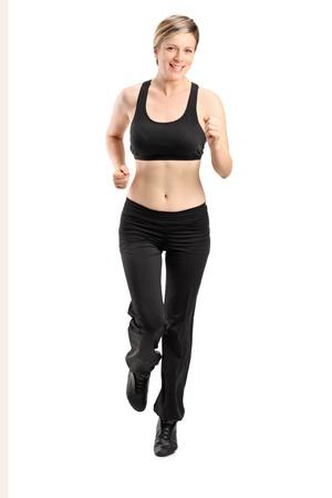 sportwear: Full length portrait of a blond female running isolated on white background