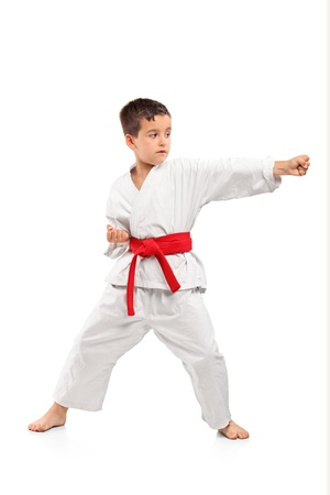 aikido: Full length portrait of a karate child exercise isolated on white background