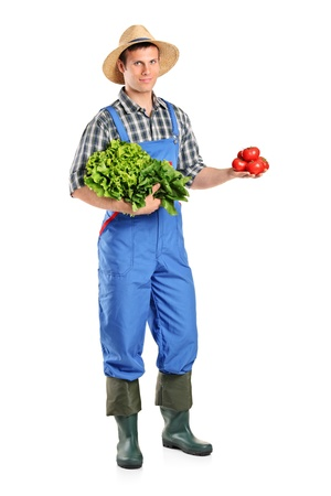 Full length portrait of a male farmer holding vegetables isolated on white background photo