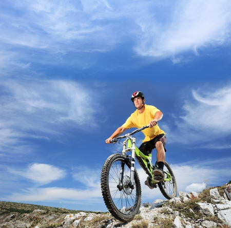 A young man riding a mountain bike outdoor Stock Photo
