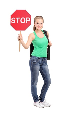 woman stop: Full length portrait of a young woman holding a traffic sign stop isolated on white background