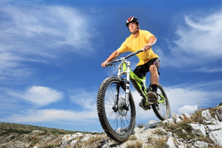 mountain biking: Male riding a mountain bike outdoor Stock Photo