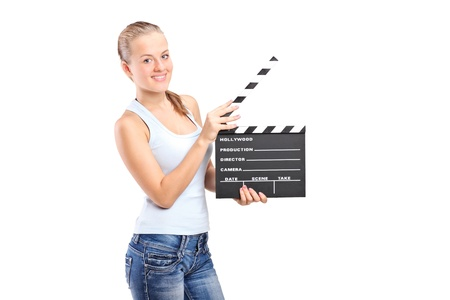 clapperboard: A happy girl holding a movie clap isolated on white background Stock Photo
