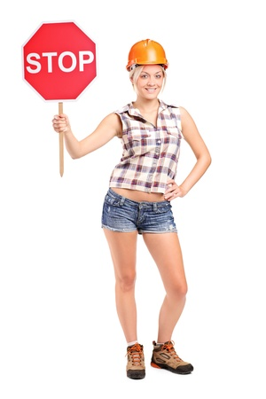 Full length portrait of a construction worker holding a traffic sign stop isolated on white background Stock Photo - 10609575