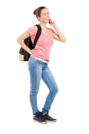Full length portrait of a female teenager talking on a mobile phone isolated on white background Stock Photo - 10609574
