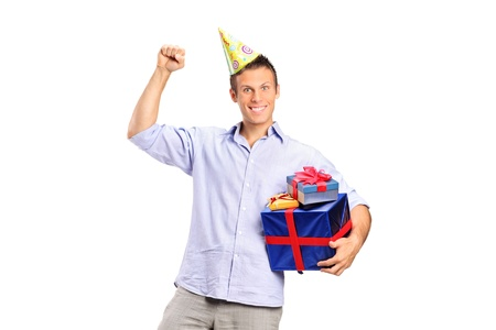 A personwearing a party hat and holding a gift isolated on white background Stock Photo - 10609605