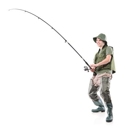 waders: Retrato de longitud completa de un pescador sosteniendo un polo de pesca aislado sobre fondo blanco