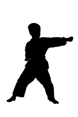 kickboxing: A silhouette of a full length portrait of a karate child exercising isolated on white background