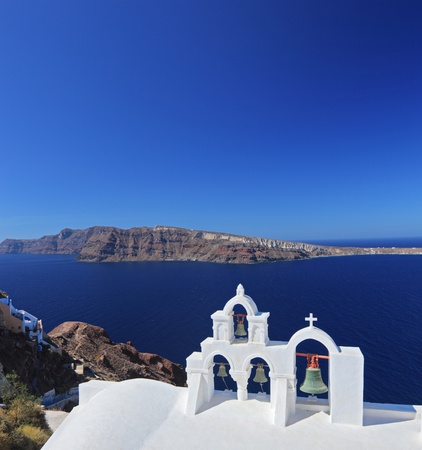 A view of a church bells on Santorini island, Greece photo