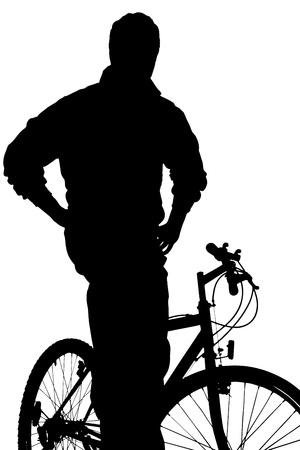 A silhouette of a  young boy posing on a bike isolated against white background photo