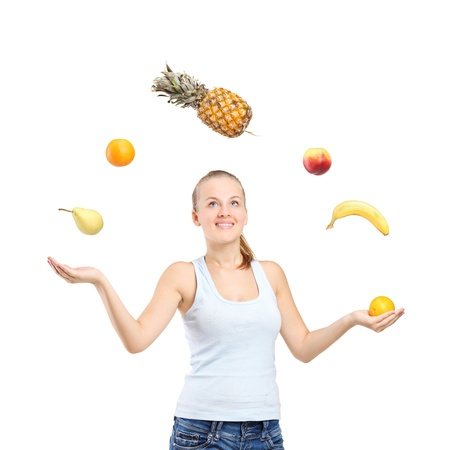 juggler: Smiling pretty woman juggling fruits isolated on white background