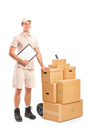 Full length portrait of a delivery person holding a clipboard and hand truck isolated on white background photo