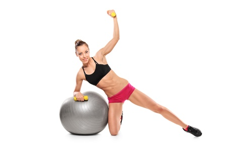 dumb bells: A female working out with a dumb bells isolated on white background Stock Photo