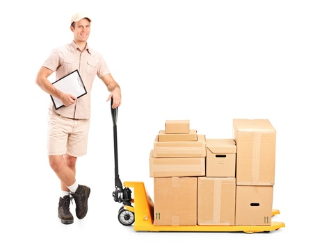 Full length portrait of a delivery person holding a clipboard and a fork pallet truck stacker isolated on white background photo