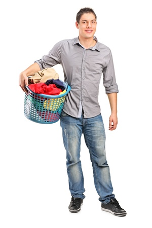 Full length portrait of a man holding an empty shopping basket isolated on white background photo