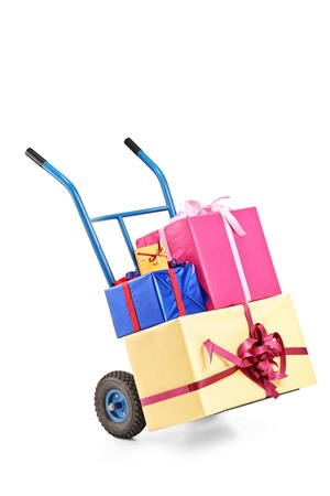 A studio shot of a hand truck with many gifts on it isolated on white background Stock Photo - 10920873