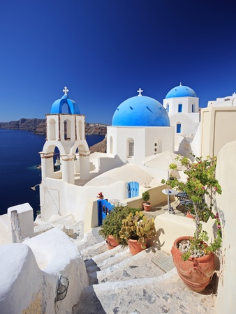 Blue dome church in Oia village on Santorini island, Greece photo