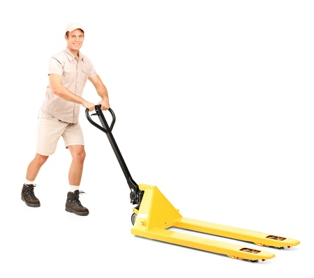 manual job: Full length portrait of a manual worker and a fork pallet truck stacker isolated on white background Stock Photo