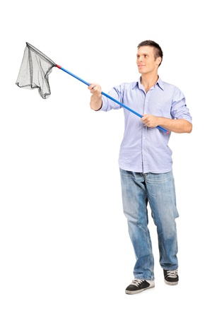 Full length portrait of a man holding an empty fishing net isolated on white background photo
