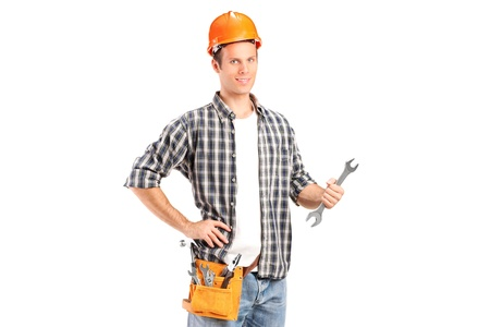A confident and smiling handyman holding a wrench isolated on white background photo