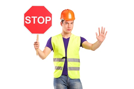 A construction worker holding a traffic sign stop isolated on white background Stock Photo - 11005103