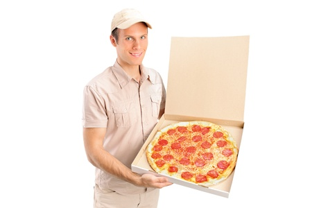 A delivery boy delivering a pizza isolated on white background photo