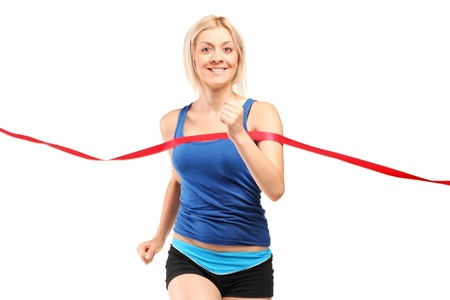 finish line: A female runner running towards a finish line isolated on white