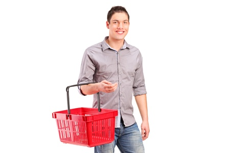 A man holding an empty shopping basket isolated on white background photo