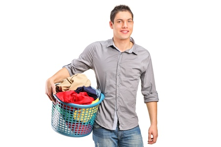 A young smiling man holding a laundry basket isolated on white background Stock Photo - 11005111